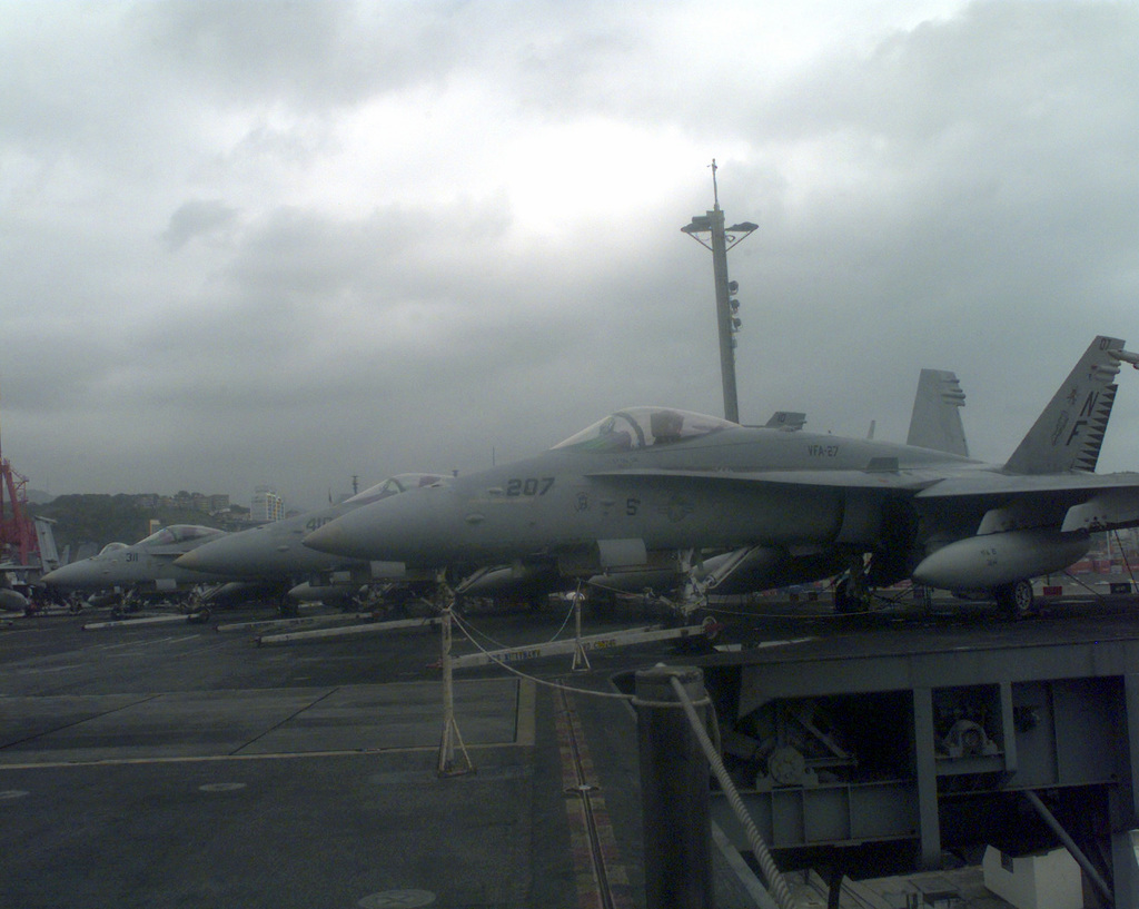 A group of F-18 Hornets, parked on the flight deck of the USS KITTY HAWK at Pier 8 in the Port of Pusan, Republic of Korea on Oct. 14, 1998. The aircraft carrier USS KITTY HAWK came to port for liberty leave and while in Korea had allowed the citizens to tour its decks. The KITTY HAWK originates from Yokosuka, Japan and is the oldest vessel in the US Navy today that is still in operation
