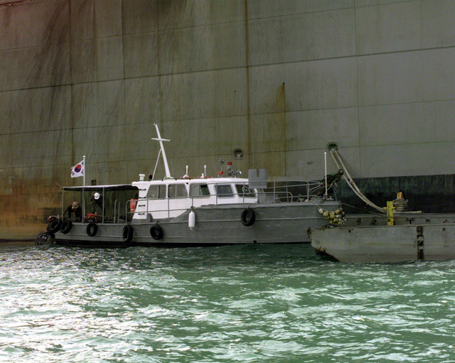 A Korean Water Ambulance puts in alongside a floating causeway moored to the United States Naval Vessel POLLUX to discharge medics in response to reports of a simulated injured sailor aboard the POLLUX on Oct. 18, 1998. This is one of the many combined training exercises being conducted jointly with United States and Republic of Korea militaries during Exercise Foal Eagle