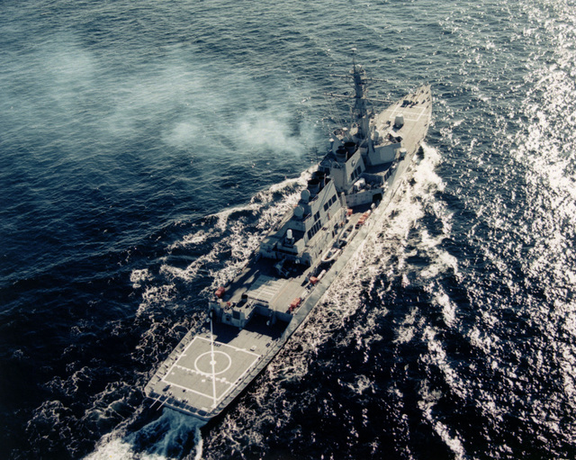 High oblique aerial view of the Arleigh Burke class guided missile destroyer USS HIGGINS (DDG 76) underway on builder's sea trials off the coast of New England