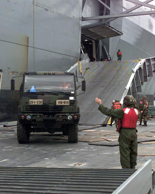 A 5 ton truck disembarks from the U.S. Navy Ship POLLUX onto a Roll on Roll off discharge facility in the Port of Pusan, Republic of Korea, Oct. 20, 1998. The POLLUX is a Fast Sealift Ship designed to upgrade lift capability and expand Army preposition afloat program. This is the first operation integrating watercraft assets from the Republic of Korea and United States