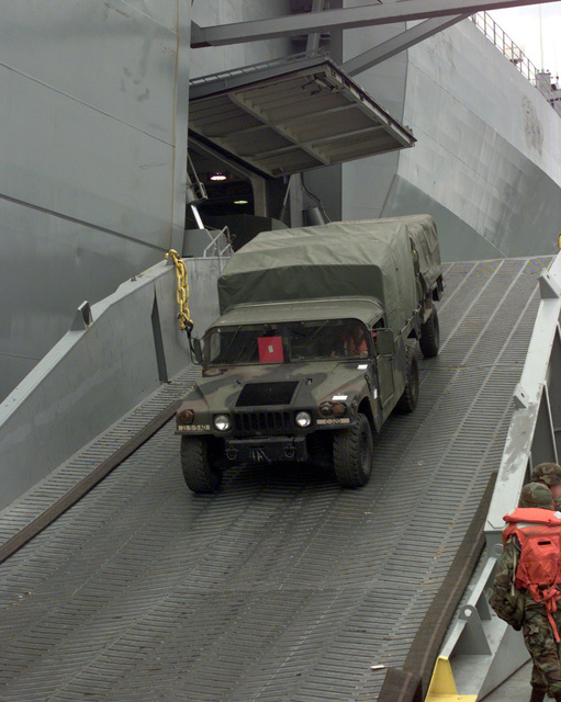 A High-Mobility Multipurpose Wheeled Vehicle (HMMWV) disembarks from the U.S. Navy Ship POLLUX onto a Roll on Roll of discharge facility in the Port of Pusan, Republic of Korea, Oct. 20, 1998. The POLLUX is a Fast Sealift Ship designed to upgrade lift capability and expand the Army preposition afloat program. This is the first operation integrating watercraft assets from the Republic of Korea and United States