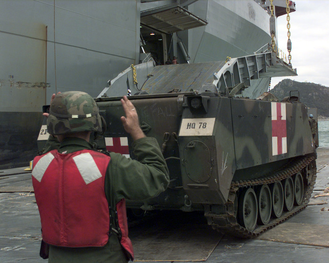 An M113 Medical Armored Personnel Carrier disembarks from the U.S. Navy Ship POLLUX onto a Roll on Roll off discharge facility in the Port of Pusan, Republic of Korea, Oct. 20, 1998. The POLLUX is a Fast Sealift Ship designed to upgrade lift capability and expand Army preposition afloat program. This is the first operation integrating watercraft assets from the Republic of Korea and United States