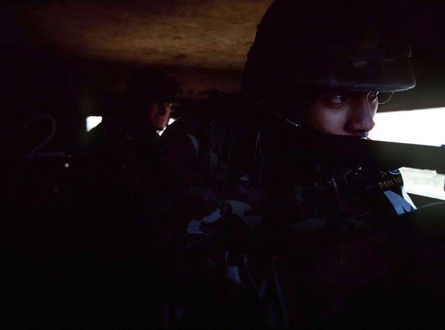 PVT Michael Mojica, United Nations Command Security Battalion/Joint Security Area (UNCSB/JSA), Scout Platoon, mans his bunker during an alert drill at Observation Post Oullette (OPO), Oct. 20, 1998. In the event of an alarm the platoon mans their posts in a matter of seconds. The platoon practices alert procedures once a day during the night or day. After being alerted the platoon heads to a central point where gear is gathered and orders for which bunker to man are given. (U.S. Air Force photo by SENIOR AIRMAN Jeffrey Allen) (Released)