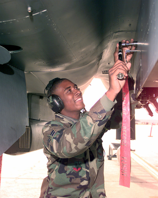 AIRMAN 1ST Class Arnette Snow, 336th Fighter Squadron Weapons Section, Seymour Johnson AFB, installs necessary hardware in preparation for installing dummy munitions on the F-15E Strike Eagle during Exercise GLOBAL GUARDIAN '98. GLOBAL GUARDIAN is held annually to test US Strategic Command's (USSTRATCOM) capabilities to deter a major attack