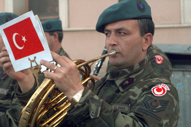 Left side front medium close-up shot of a member of the Turkish Army band. On 23 Oct 1998, US Army General Eric K. Shinseki (Not shown), Commander of Stabilization Force (SFOR), relinquished his command to US Army General Montgomery C. Meigs (Not shown), the commander of the U.S. Army combined Arms Center and Fort Leavenworth. Forty nations supporting Operation Joint Forge, participated in the change of command on the Ilidza Compound in Sarajevo, Bosnia. US Army General Wesley K. Clark (Not shown), the Supreme Allied Commander of Europe, and Mr. Sergio Balanzino (Not shown), NATO Deputy Secretary General, were the guest speakers for the ceremony