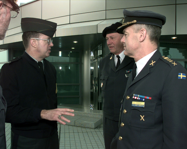 COL Donald Kropp, United Nations Command Secretariat, talks with visitors at Panmunjom, Republic of Korea, prior to the caravan of 501 cattle and 50 vehicles entering the Communist North Korea, Oct. 27, 1998. South Korean business tycoon Chung Ju-yung, founder and honorary chairman of Hyundai Group, donated 501 head of cattle and the vehicles to the famine-stricken country. Mr. Chung had given the North Koreans 500 head of cattle earlier this year in June
