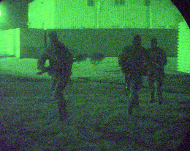 Opposing forces comprising of the 51st Security Forces Squadron (SFS), Osan Air Base, Republic of Korea (ROK) and the 15th SFS, Hickam Air Force Base, Hawaii, try to infiltrate the flight line during a night assault at Kunsan Air Base, Republic of Korea, Oct. 27, 1998. Several Air Force organizations are at Kunsan Air Base participating in Foal Eagle'98