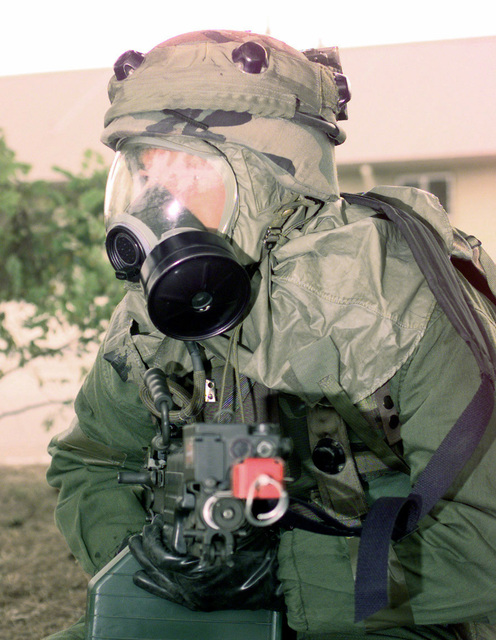 SRA Scott Humphries, assigned to the 137th Security Forces Squadron, Peterson Air Force Base, Colorado, takes a defensive position after a simulated chemical attack at Kunsan Air Base (AB), Republic of Korea, Oct 28, 1998. SRA Humphries and several other Air Force personnel are at Kunsan AB to participate in Foal Eagle '98
