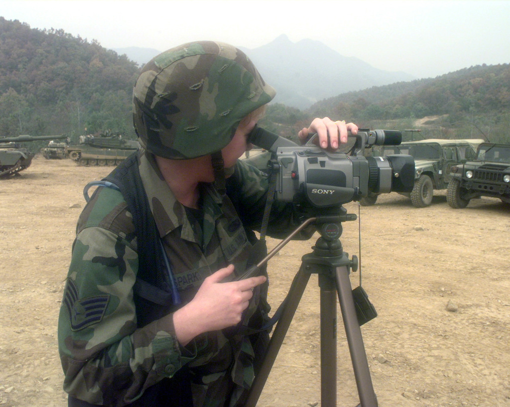 SSGT Becky Sparks, a videographer, documents site Tactical Assembly Area Santa Barbara in Wonapsan, Republic of Korea, Oct. 30, 1998. Sparks is from the 1ST Combat Camera Squadron out of Charleston Air Force Base, S.C. Her squadron is in Korea to document Foal Eagle '98, a combined exercise involving the Republic of Korea Army and the United States Armed Forces