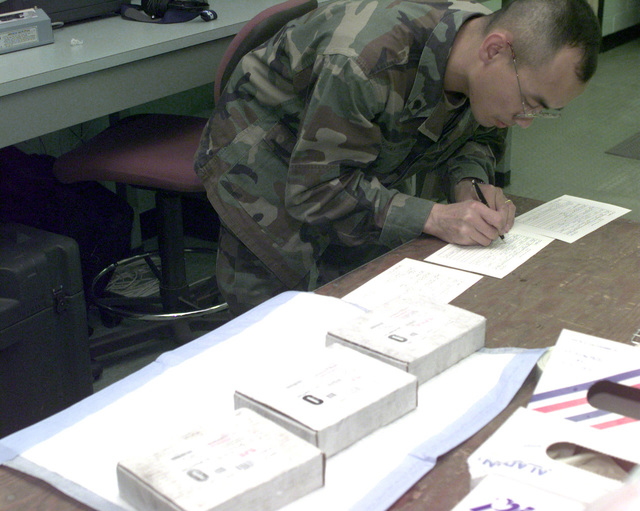 SPC Vilayphone Sisouphanthong fills out information cards on three units of blood at the Camp Carroll Frozen Blood Depot in Republic of Korea, Nov. 1, 1998. Sisoupanthong, of Alpha Company, 16th Medical Logistics Battalion, is preparing to send blood to a battlefield exercise in support of Foal Eagle '98. Foal Eagle is a deployment exercise that takes place once a year in Korea