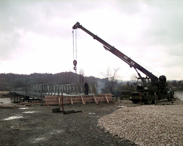 Supply routes for Stabilization Force (SFOR), Personnel have to be in good condition to allow freedom of movement in Bosnia-Herzegovina. Many bridges are downgraded by Stabilization Force (SFOR), Engineers due to various safety reasons. A bridge in Doboj, failed an inspection due to heavy traffic flow. The solution to the problem is the Mabey and Johnson Bridge which is to be built by the Hungarian Engineering Contingent. The project has been on going since September and is expected to be completed November 21, 1998. Today the Hungarians latched decking sections on the Bridges skeleton that will enable travel across the Bosnia river
