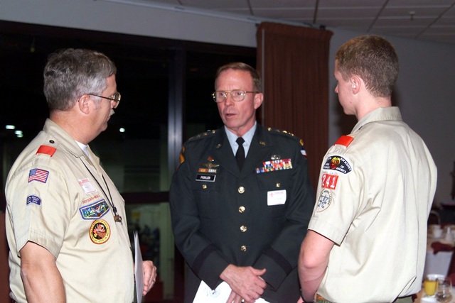 US Army Lieutenant General John M. Pickler (Center), CHIEF of STAFF, Forces Command, Fort McPherson, Georgia, talks with a Boy Scout (Right) and Scout leader at the Executive Branch at the Atlanta, GA., 1998 Scout Show held at the World Congress Center in Downtown Atlanta