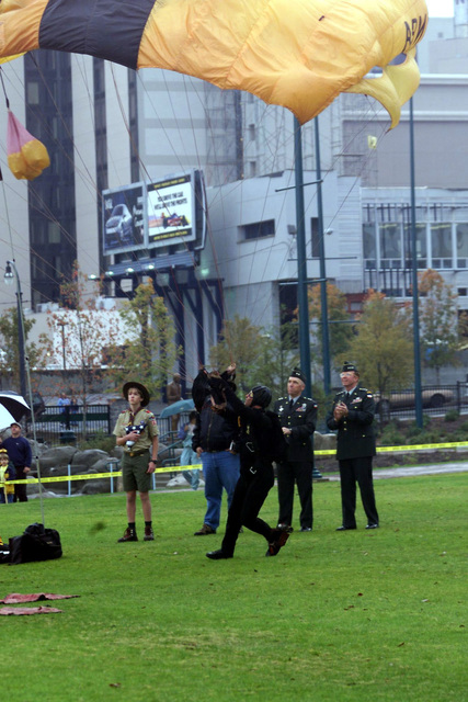 US Army Lieutenant General John M. Pickler (Right), CHIEF of STAFF, Forces Command, Major General Geoffery Miller (2nd from Right), Deputy CHIEF of STAFF for Personnel and Installation Management, Fort McPherson, Georgia, and a selected Boy Scout watch as members of the Army's elite Golden Knights Parachute Team jump into Centennial Olympic Park for the Atlanta, Georgia, Council Boy Scout Show