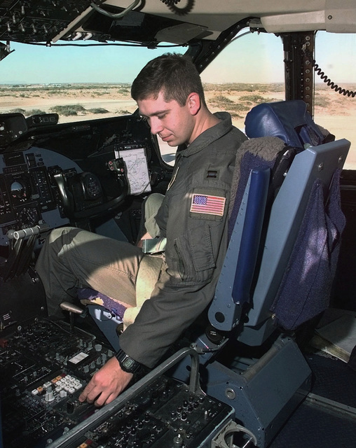 Captain Jeff Daniels, USAF, a C-5 Galaxy pilot with the 312th Airlift Squadron from Travis AFB, California, resets the instrument panel after landing at Biggs Army Air Field at Fort Bliss in El Paso, Texas. The C-5 landed at Biggs Army Air Field to pick up troops and equipment for transport to Southwest Asia