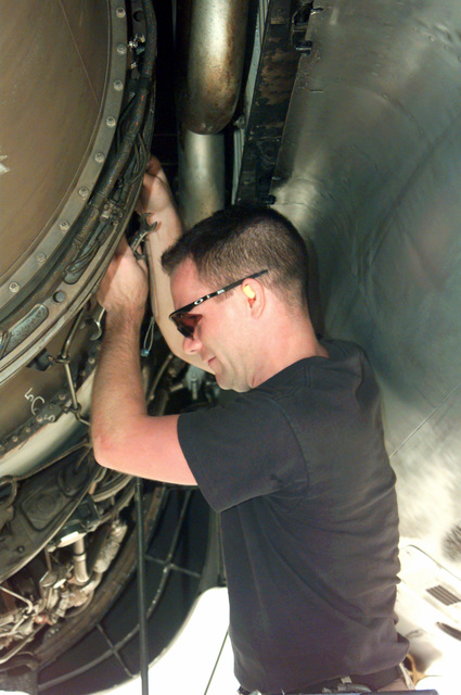 US Navy STAFF Sergeant Bryon Trowbridge, 96th Bomb Squadron, Barksdale Air Force base, Louisiana, double checks the engine that gave a problem indicator light during engine runs on a B-52H Stratofortress aircraft at Naval Station Diego Garcia. The 96th Bomb Squadron and support personnel from the 2nd Bomb Wing, Barksdale Air Force base, Louisiana, are deployed to Diego Garcia in support of Operation DESERT THUNDER 2