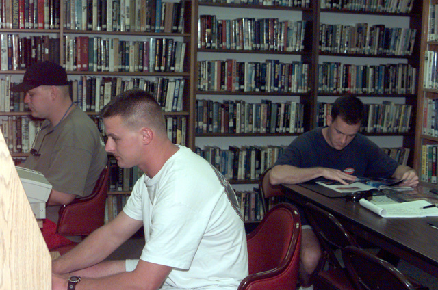 US Air Force STAFF Sergeant Robert Brinkman and US Air Force STAFF Sergeant Bryon Trowbridge, 96th Bomb Squadron, Barksdale Air Force Base, Louisiana, take advantage of the E-mail and reading facilities at the library on Naval Station Diego Garcia. The 96th Bomb Squadron and support personnel from the 2nd Bomb Wing are deployed to Diego Garcia in support of Operation DESERT THUNDER 2