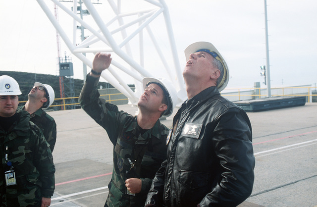 US Air Force STAFF Sergeant Robert Bodell of the 2nd Space Launch Squadron at Vandenberg Air Force Base, California, takes US Air Force General Richard B. Myers on a tour of Space Launch Complex 4E and the Titan II Space Launch Vehicle