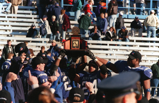Falcon players celebrate a win in the Western Athletic Conference Championship game at Sam Boyd Stadium. Air Force Academy defeated Brigham Young University 20-13 to claim it first Western Athletic Conference title