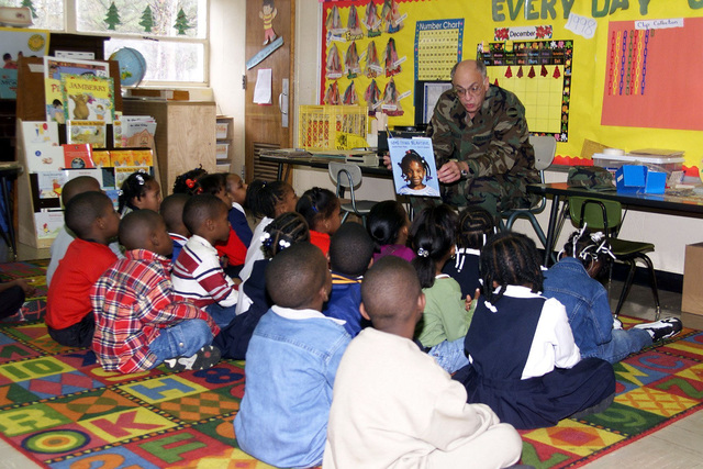 US Army Major General Robert D. Shadley (Facing Camera), Deputy CHIEF of STAFF for Logistics, Forces Command, Fort McPherson, Georgia, reads to the Kindergarten Class at Preston Arkwright Elementary School. Forces Command supports the school as part of the Partners in Education Program