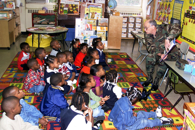 US Army Major General Robert D. Shadley (Right), Deputy CHIEF of STAFF for Logistics, Forces Command, Fort McPherson, Georgia, reads to the Kindergarten Class at Preston Arkwright Elementary School. Forces Command supports the school as part of the Partners in Education Program