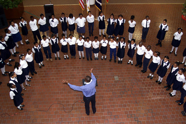 The Chorus from Preston Arkwright elementary school sings Christmas Carols for the people at Forces Command, Fort McPherson, Georgia. Forces Command supports Arkwright Elementary through the Partners in Education Program