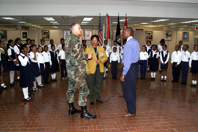 US Army General Thomas A. Schwartz (Left), Commanding General, Forces Command, welcomes the Preston Arkwright Elementary School Chorus to Forces Command, Fort McPherson, Georgia. Forces Command supports Arkwright School as part of the Partners in Education Program