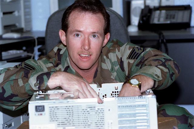 STAFF Sergeant Mark McDaniel holds the 169th Communications Flight personnel status board