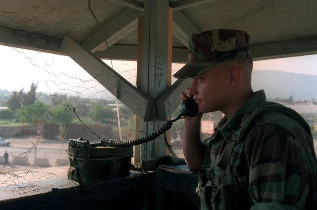 Lance Corporal Adam Nieves, 3D Battalion, 2D Marines, conducts security checks over the TA-312 field phone at Post #2, which provides perimeter security for USSGH, Camp Fairwinds. US Support Group Haiti (USSGH) is stationed in Port Au Prince, Haiti in support of Operation UPHOLD DEMOCRACY established to improve the infrastructure and the health of the Haitian population