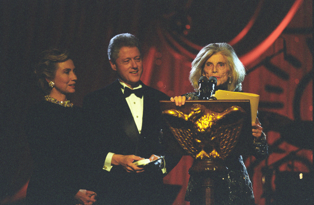 Photograph of Eunice Kennedy Shriver Delivering Remarks with President William Jefferson Clinton and Hillary Rodham Clinton at a White House Special Olympics Dinner