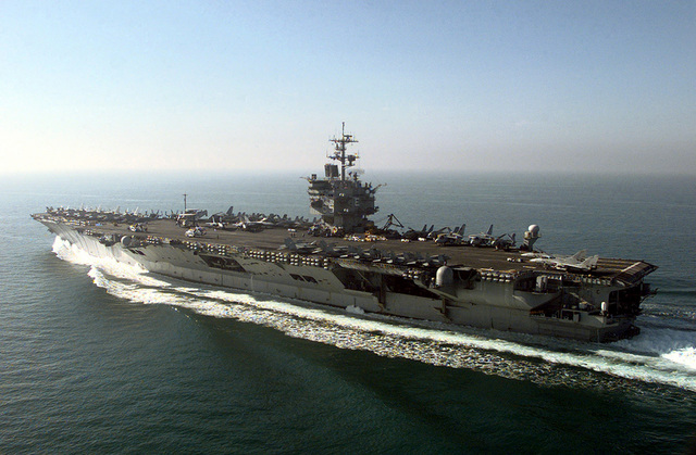 The aircraft carrier USS ENTERPRISE (CVN-65) makes its way to the southern end of its operating area the morning after the first wave of air strikes against Iraq during DESERT FOX