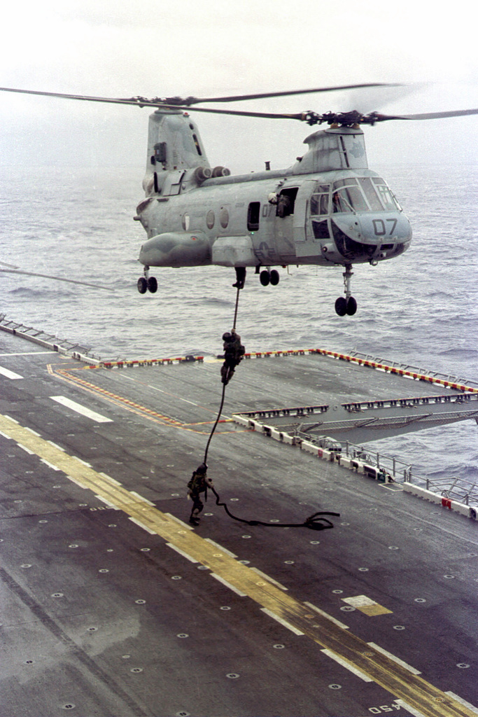 Marines from the Force Reconnaissance Platoon, 13th Marine Expeditionary Unit (MEU), Special Operations Capable (SOC), US Marine Corps, conduct fastrope training from a CH-46E Sea Knight helicopter onto the flight deck of the USS BOXER (LHD 4) to maintain their proficiency during a Western Pacific deployment, WestPac 99-1