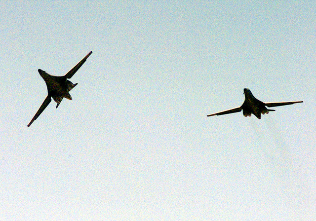 View from the ground up at two U.S. Air Force B-1B Lancer bombers from the 9th Bomb Squadron, 7th Bomb Wing, Dyess Air Force Base, Texas, as they return on December 25th, 1998, after participating in Operation Desert Fox