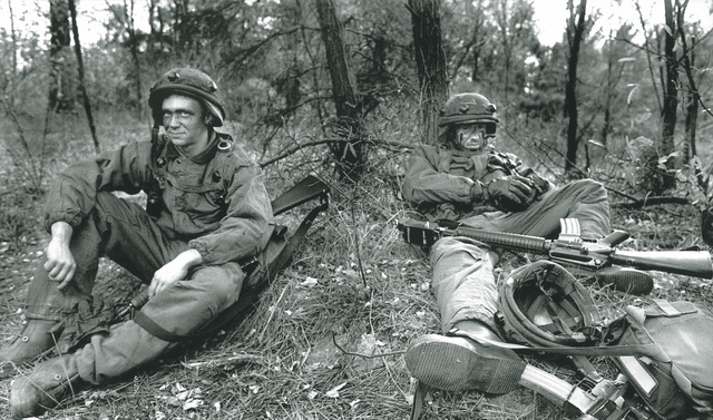 "Military Photographer of the Year Winner 1999 TITLE: ""A View From the Front"" CATEGORY: Combat Camera PLACE: Second Place Combat Camera CAPTION INFORMATION: After a fierce day of combat training, two Army soldiers take a moment to rest during a training exercise at Fort Meade, MD. IMAGE FILE #DD-SP-01-00004"