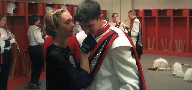 "Military Photographer of the Year Winner 1999 TITLE: ""The Locker Room"" CATEGORY: Feature PLACE: Second Place Feature CAPTION INFORMATION: Brandi Rose from Phoenix High School gently pulls Mike Butlers chin towards her lips for a good luck kiss before their school performs in the 1999 New York Marching Band competition held in the Carrier Dome at Syracuse University. IMAGE FILE #DD-SP-01-00008"