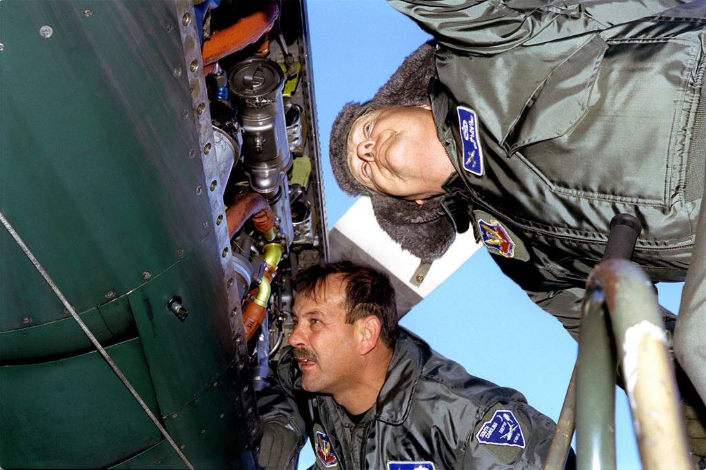 Technical Sergeant Bill Dimsdale, and MASTER Sergeant Bill Allen, crew chiefs, for the 169th Operations Support Flight (OSF), troubleshoot a secondary fuel pump pressure switch on engine number three at Charleston Air Force Base, South Carolina. The 169th OSF is assigned to the 169th Fighter Wing at McEntire Air National Guard Station in South Carolina. During this five-day mission, this crew will make two trips to Soto Cano AB, Honduras. They will deliver much needed water purification units, food, and medical supplies to assist local civilians affected from the aftermath of Hurricane Mitch
