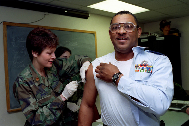 MASTER Sergeant Julius Moore of the 169th SPS, receives his first Anthrax innoculation of a series from Major Theresa Prince, CHIEF of Nursing Services at McEntire Air National Guard Station, Eastover, South Carolina