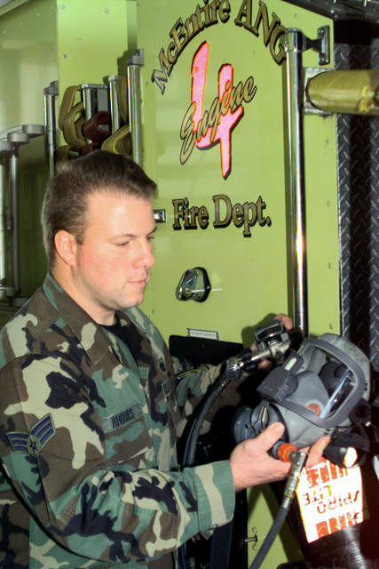 SENIOR AIRMAN John Rhodes checks his mask for leaks. SRA Rhodes is a member of the McEntire Air National Guard Station Fire Department, 169 CES/DEF. In his civilian job he works for the North Charleston South Carolina Fire Department