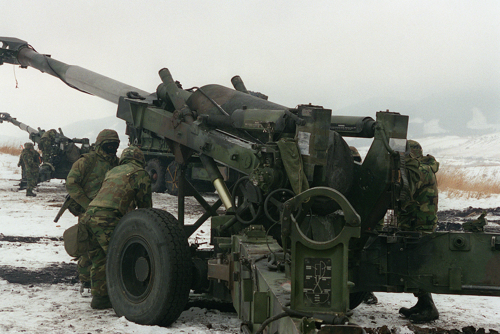 US Marine Corps (USMC) personnel assigned to the 3rd Battalion, 12th Marine Regiment perform per-fire inspections on M198 155mm Towed Howitzers during a live-fire training exercise at Jijudai training range Kyushy, Japan