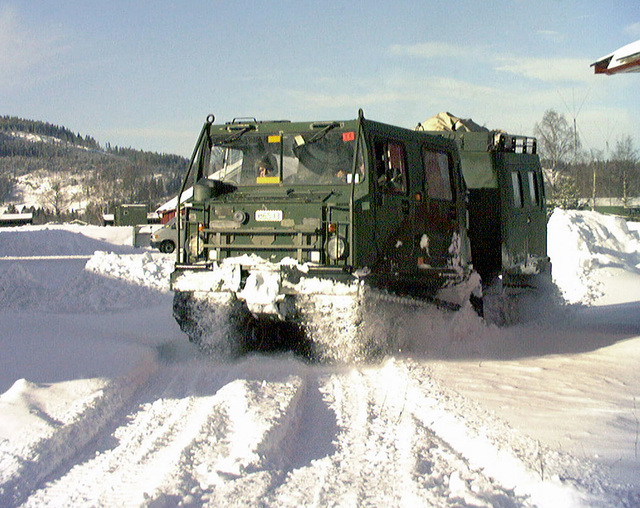 A Barrier Vehicle (BV) plows through the deep snow at the II Marine Expeditionary Force (MEF) Command Post on Camp Rinnleiret, Norway. BV's were used heavily in Exercise BATTLE GRIFFIN '99 to transport supplies like food and ammunition to forward units who were unreachable by any other means of transportation. BATTLE GRIFFIN is a triennial combined Joint Field Exercise (FTX)