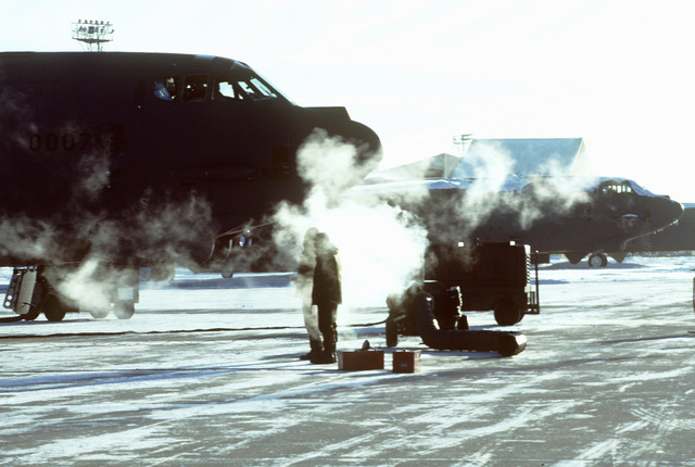 The mist of icy breath and frozen exhaust cloud the ramp during a B-52 Stratofortress engine test on March 1ST, 1999, at Minot Air Force Base, North Dakota