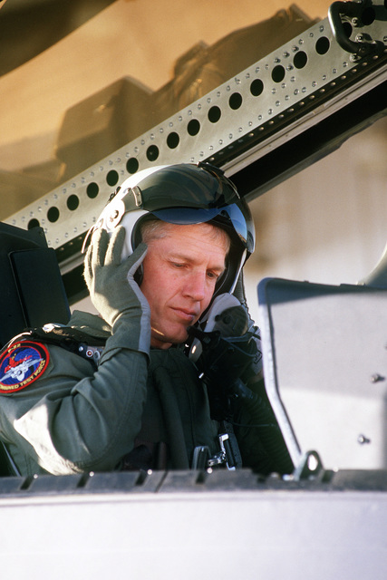 US Air Force Lieutenant Colonel Dave Nelson, F-22 Raptor test pilot at Edwards Air Force Base, California, dons flight gear to prepare for a test flight on March 1ST, 1999, as part of the F-22 Combined Test Force including Lockheed, Boeing and Pratt and Whitney