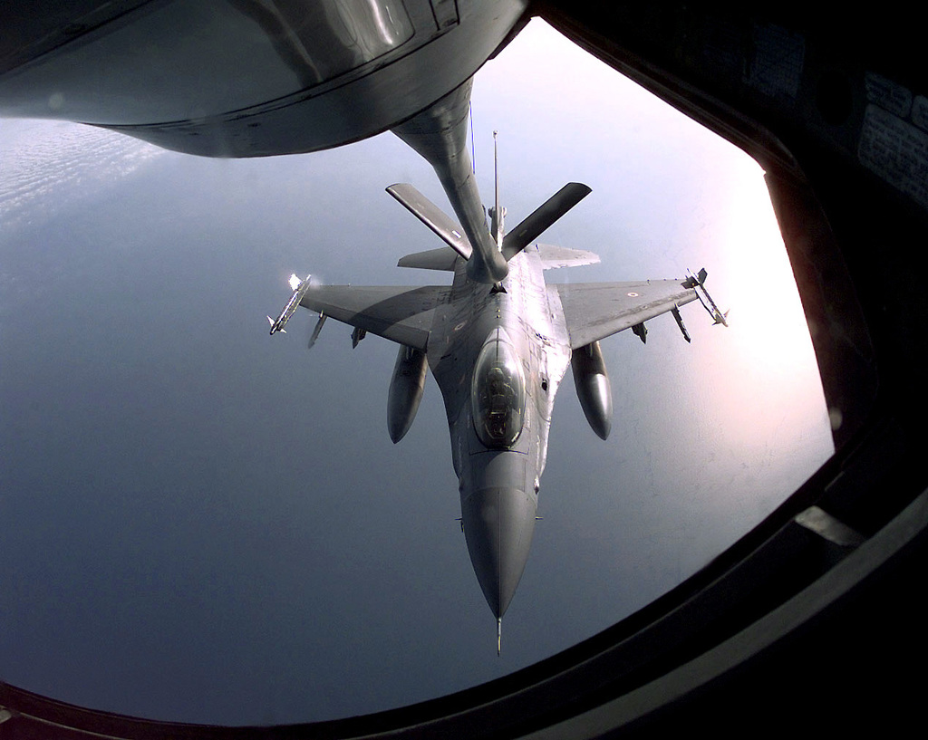 A US Air Force KC-135 Stratotanker from the 344th Aerial Refeuling Squadron, McConell Air Force Base, Kansas, passes fuel to a Danish F-16 Falcon during a refueling mission in a forward location in the European Theatre. This mission is in direct support of Joint Task Force Noble Anvil