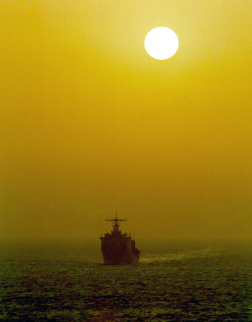 Port bow view of the US Navy (USN) Dock Landing Ship, USS HARPERS FERRY (LSD 49) underway in the Arabian Sea at sunrise. The Harpers Ferry is one of three ships in the Boxer Amphibious Ready Group currently deployed to the Arabian Sea in support of Fifth Fleet operations