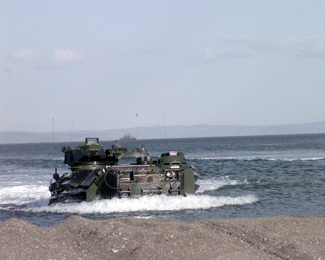 US Marine Corps Amphibious Assault Vehicles come ashore in coordination with Greek Marines during Exercise ALEXANDER THE GREAT in Volos, Greece. The 24th Marine Expeditionary Unit is embarked aboard the three ships (not shown) of the NASSAU Amphibious Readiness Group, USS NASHVILLE (LPD 13), USS PENSACOLA (LSD 38) and USS NASSAU (LHA 4). The NASSAU ARG and 24th MEU (SOC) are on a routine six month deployment to the US SIXTH Fleet in the Mediterranean