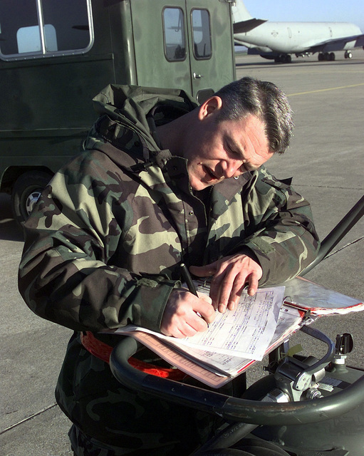 US Air Force STAFF Sergeant Darrell Bramer, a KC-135 Stratotanker Crew CHIEF, assigned to the 92nd Aircraft Generation Squadron, Fairchild Air Force Base, Washington, completes the paperwork after re-installing forward body fuel tank access panels (Not shown) on a KC-135 while deployed to Moron Air Base, Spain. This mission is in direct support of Joint Task Force Noble Anvil