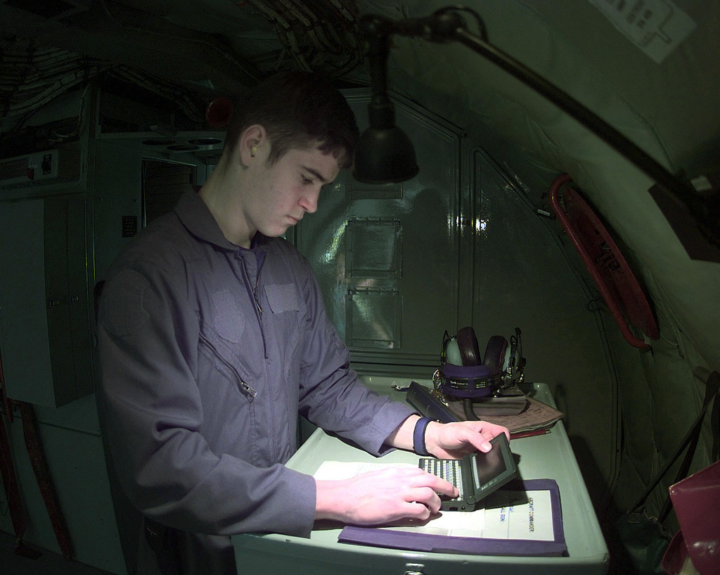US Air Force SENIOR AIRMAN Vince Estes, a KC-135 Stratotanker Boom Operator, assigned to the 97th Aerial Refueling Squadron, Fairchild Air Force Base, Washington, is currently deployed to the 100th Air Expeditionary Wing, Royal Air Force Base Mildenhall, completes his prefilght checks prior to a mission in support of Operation Allied Force