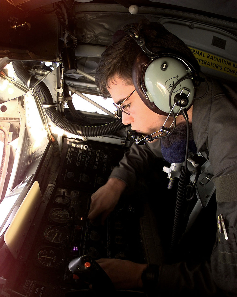 US Air Force SENIOR AIRMAN Vince Estes, a KC-135 Stratotanker Boom Operator, assigned to the 97th Aerial Refueling Squadron, Fairchild Air Force Base, Washington, currently deployed to the 100th Air Expeditionary Wing, Royal Air Force Base Mildenhall, prepares the Aerial Refueling Boom for contact while on a mission in support of Operation Allied Force