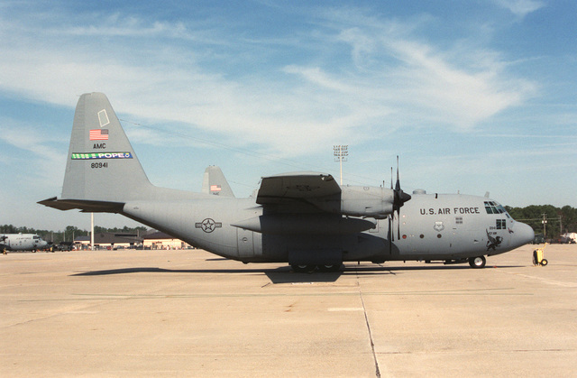 A 43rd Airlift Wing C-130E in full unit markings. The 43rd Fighting Gryphon adorns the nose with the US Air Force and Air Mobility Command shield on the forward fuselage. The combat style national insignia is on the rear fuselage. The AMC style tail band has been changed to a split green/blue with the 43rd Airlift Wing shield replacing the individual squadron emblems.Photographer: Dave Davenport, CivilianService Shown: F