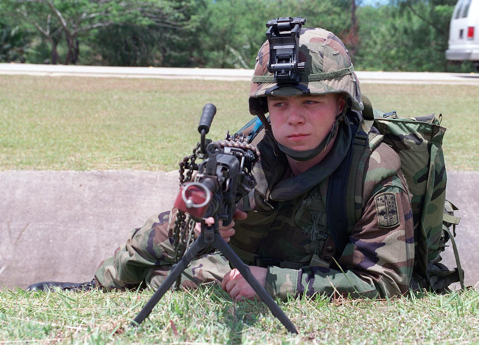 Corporal Daniel Krug US Army USA 1ST Battalion 17th Infantry Division Mans His 556mm M249