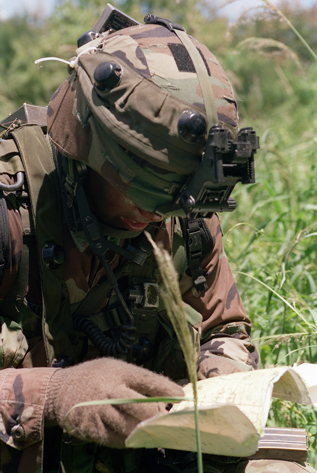 US Army Sergeant SGT Williams 1ST Battalion 17th Infantry Division Checks His Map During A Patrol On Tinian Island Operation TANDEM THRUST 99